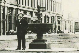 Gentleman standing by WCTU Fountain - 1914